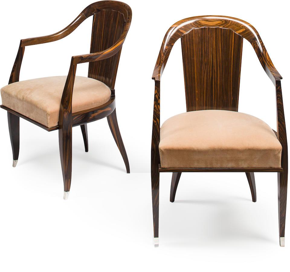 A pair of Emile-Jacques Ruhlmann macassar ebony and silvered bronze Cannelé armchairs Created for the Viville-Yardley Showroom, 24 avenue de l'Opéra, Paris, circa 1926