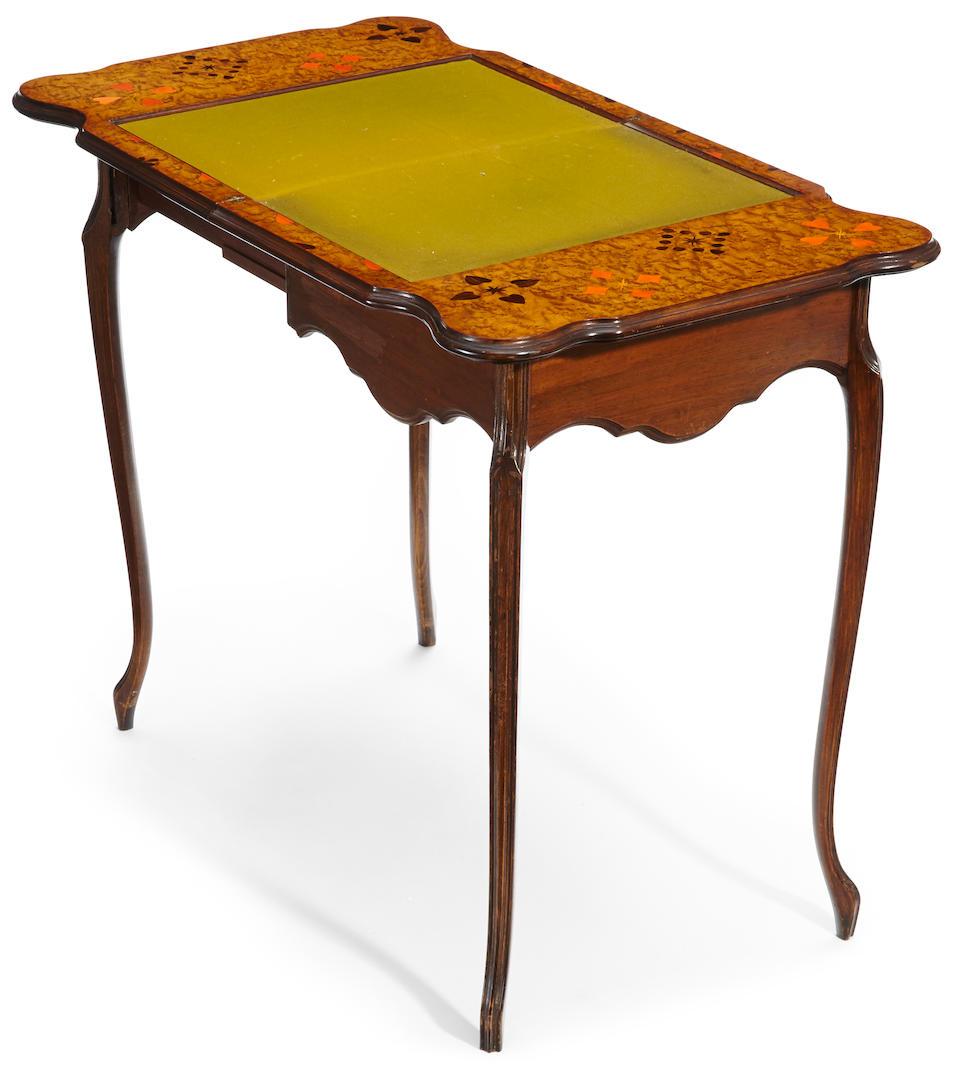 An Émile Gallé marquetry and fruitwood table á jeux circa 1900