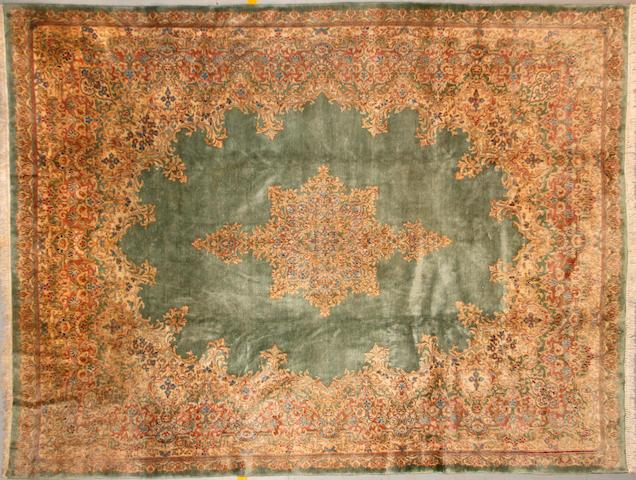 A Kerman carpet size approximately 9ft. x 12ft.