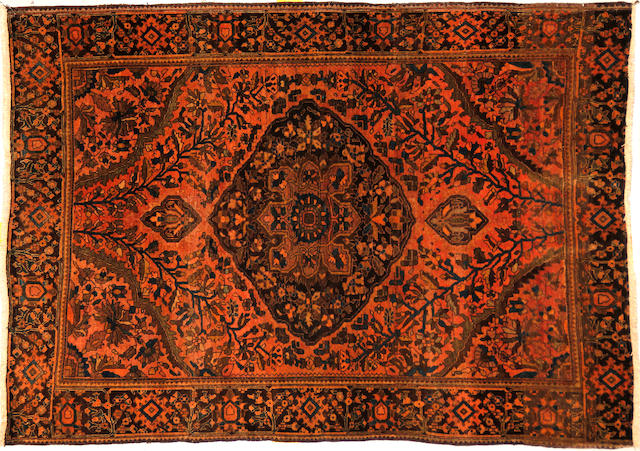 A Fereghan Sarouk rug size approximately 3ft. 4in. x 4ft. 9in.