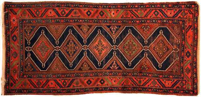 A Caucasian rug size approximately 4ft. 11in. x 8ft. 6in.