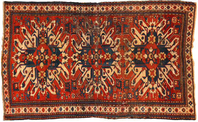 An Eagle Kazak rug size approximately 4ft. 9in. x 7ft. 8kin.
