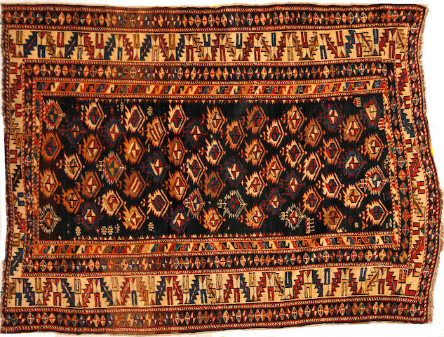 A Shirvan rug size approximately 4ft. x 5ft. 2in. size approximately 4ft. x 5ft. 2in.