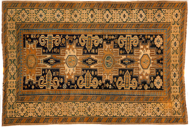 A Kuba rug  size approximately 3ft. 8in. x 5ft. 3in.