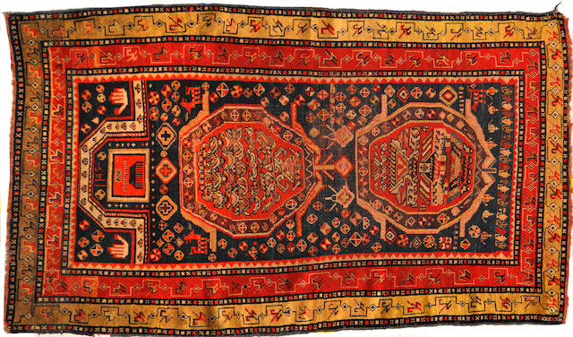 A Kazak rug  size approximately 3ft. 11in. x 5ft. 6in.