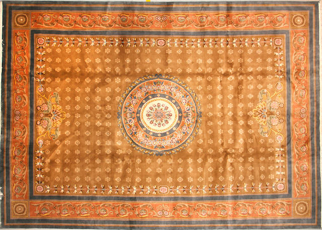 A Chinese carpet size approximately 10ft. x 14ft.