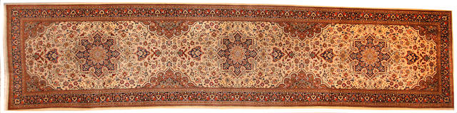 A Tabriz runner size approximately 3ft. 4 1/2in. x 14ft. 6in.