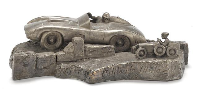 A Ferrari Mille Miglia bronze by Lawrence Braun, 12 X 7 X 3 ins.