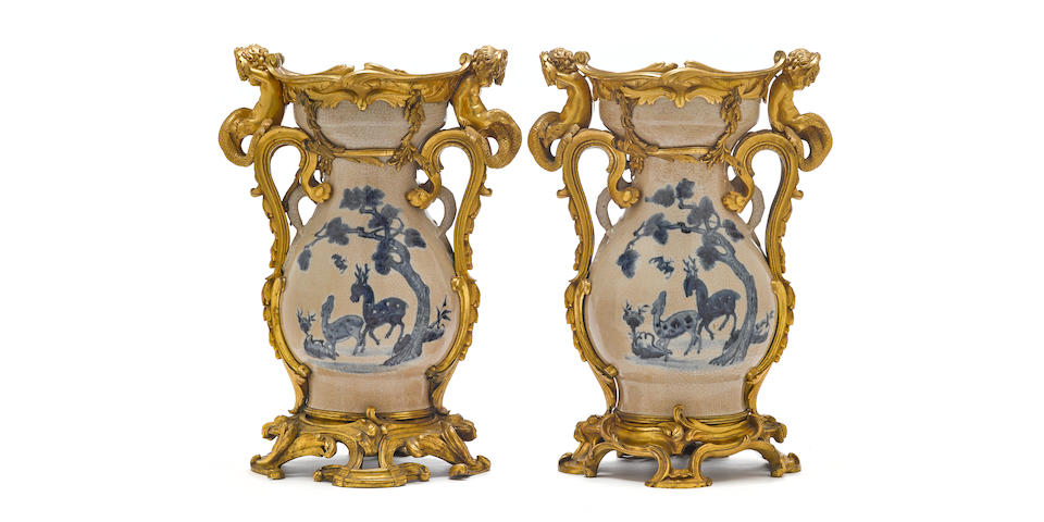 A fine pair of Louis XVI style gilt bronze mounted Chinese blue and white crackle glazed porcelain vases 19th century