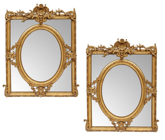 A pair of Napoleon III style giltwood and gilt composition mirrors