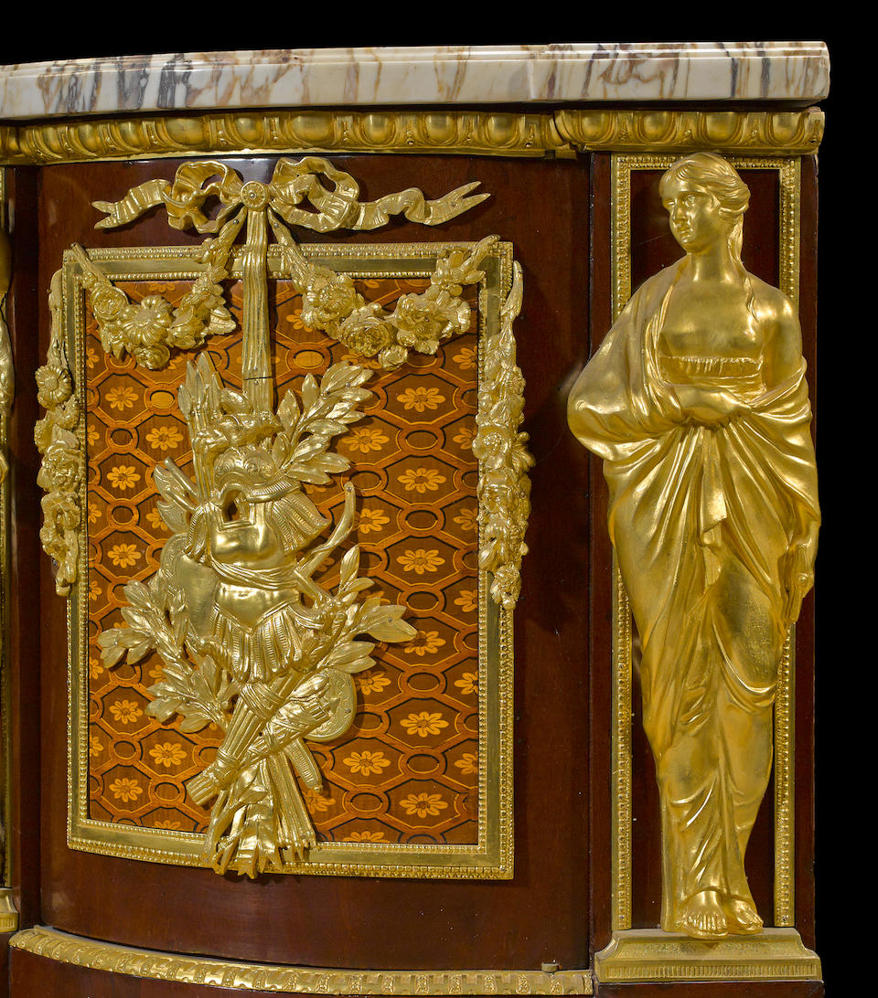 A Regal Régence style gilt bronze mounted parquetry commode after a model by J.H. Riesener, now in the Musée Condé, Chantillyfourth quarter 19th century