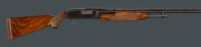A 12 gauge Winchester Model 12 slide action shotgun