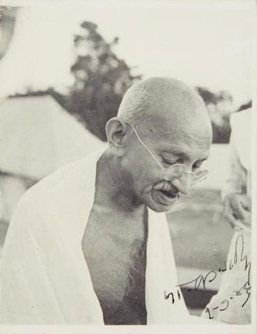 GANDHI, MOHANDAS K. 1869-1948. Photograph Signed