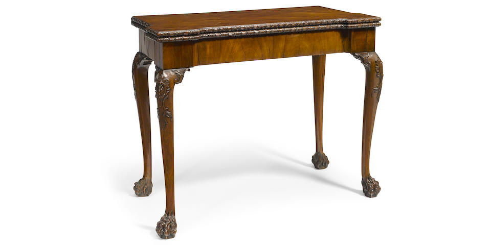 A fine George II carved walnut concertina action fold top games table second quarter 18th century