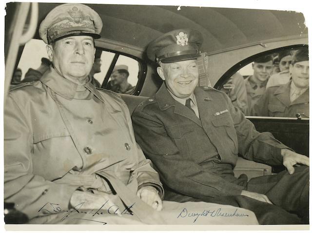 """EISENHOWER, DWIGHT D., & DOUGLAS MACARTHUR. Photograph Signed (""""Dwight D Eisenhower"""" and """"Douglas MacArthur""""), 7 1/2 x 10 inch silver print,"""