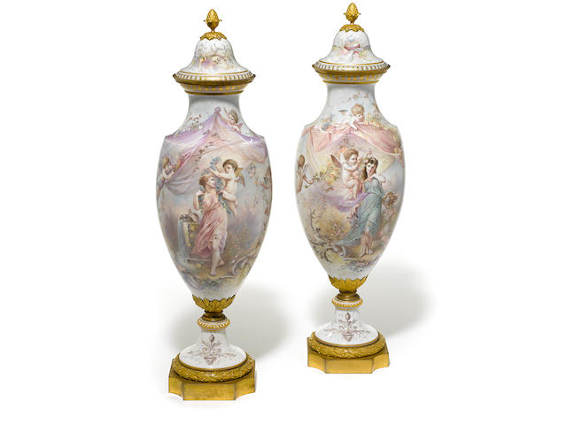 A good quality pair of French gilt bronze mounted porcelain covered vases late 19th century