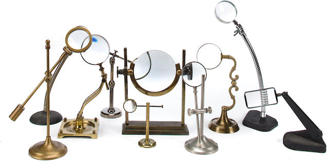 A collection of ten magnifying glasses on stands 20th century 11-1/2 x 8-3/4 in. (29.2 x 22.2 cm.), height x width. 10