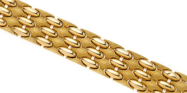 A retro 18k gold wide bracelet,