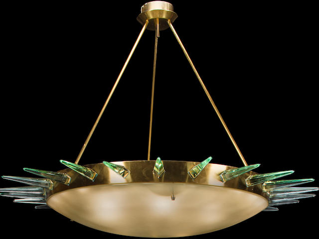 A Max Ingrand chisel cut and frosted glass and brass chandelier produced by Fontana Arte, circa 1956