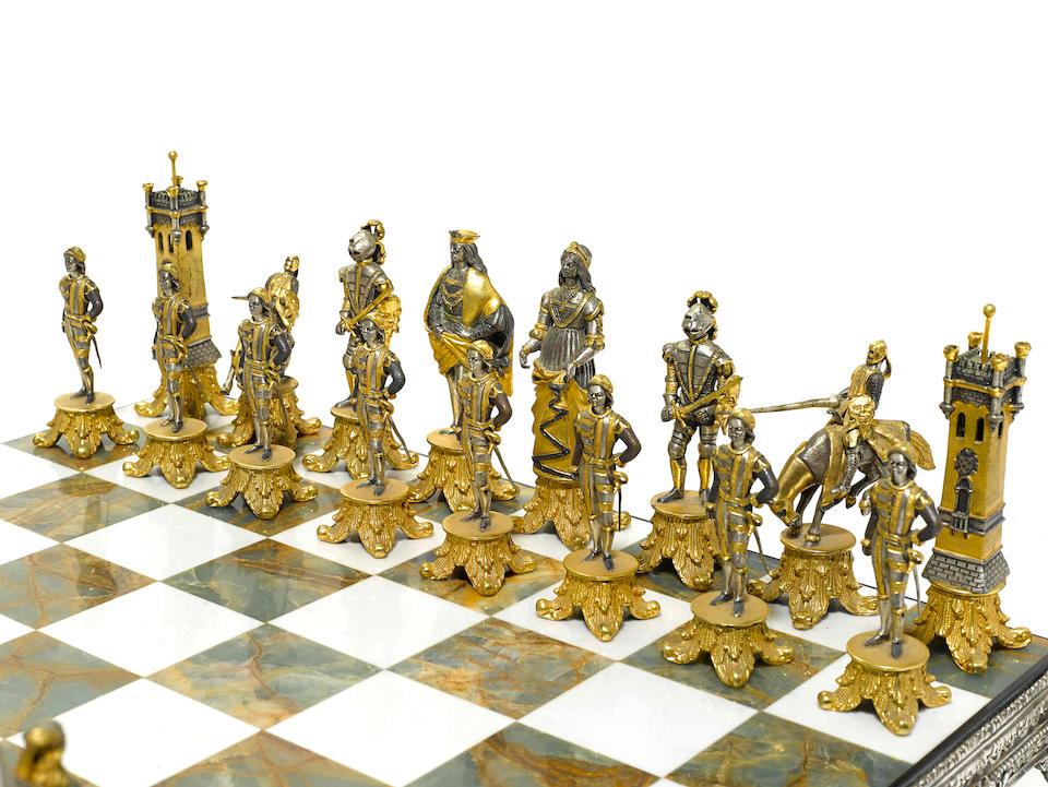 A Giuseppe Vasari silvered and gilt  metal, silver and onyx Scacchiera Bizantina chess set circa 1970