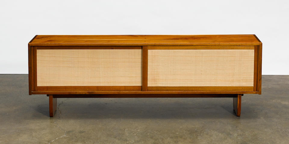 George Nakashima (1905-1990)  Credenzacustom designed, and executed circa 1955, American black walnut, pandanus clothheight 24in (60.96cm); width 72in (182.88cm); depth 14 1/4in (36.19cm)