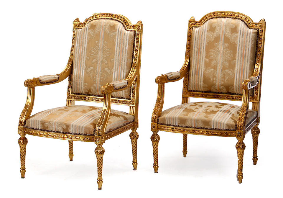 A Louis XVI style giltwood salon suite late 19th/early 20th century