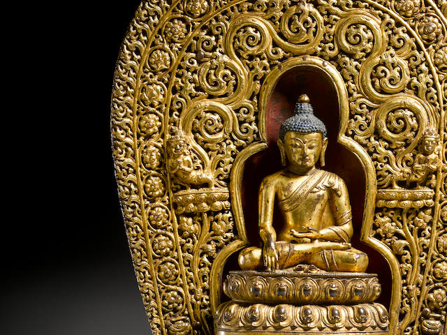 A gilt copper alloy figure of Shakyamuni with prabhamandala Tibet, circa 15th century