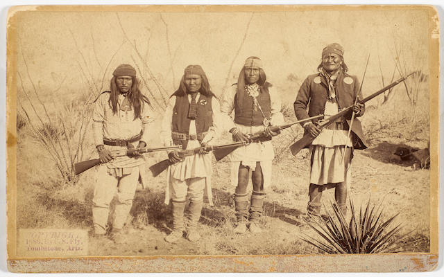GERONIMO, SON & TWO PICKED BRAVES. Albumen print photograph, 4 3/4 x 8 1/8 inches, Tombstone, Arizona, 1886,