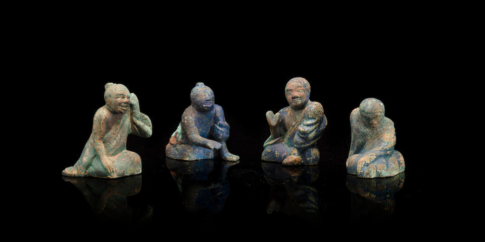 A rare set of four bronze figural weights Han dynasty