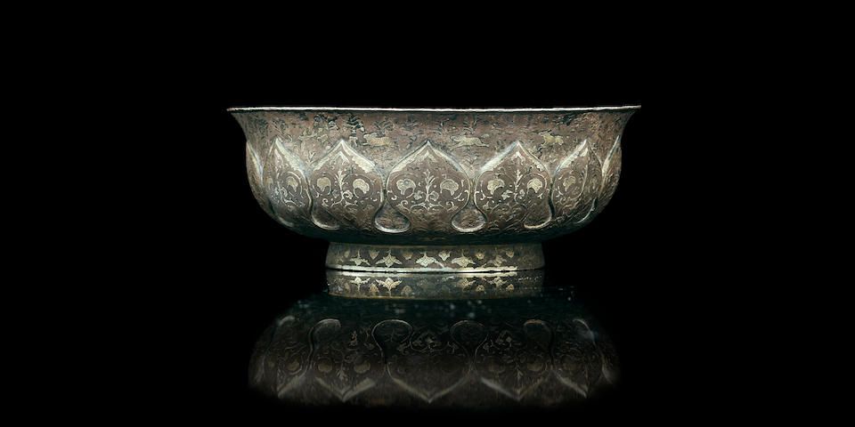 A rare repoussé and parcel-gilt silver bowl Tang dynasty, early 8th century