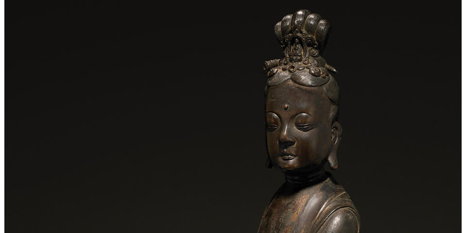A fine cast bronze seated figure of Guanyin  17th century