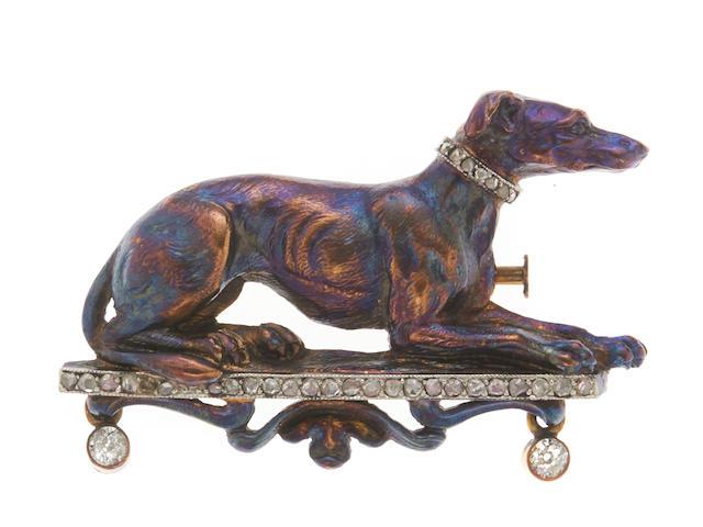 A diamond, platinum and 18k gold dog brooch,