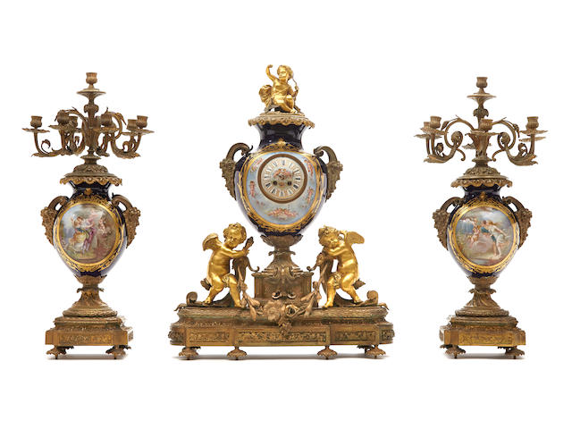 A French gilt bronze and porcelain clock garniture late 19th century