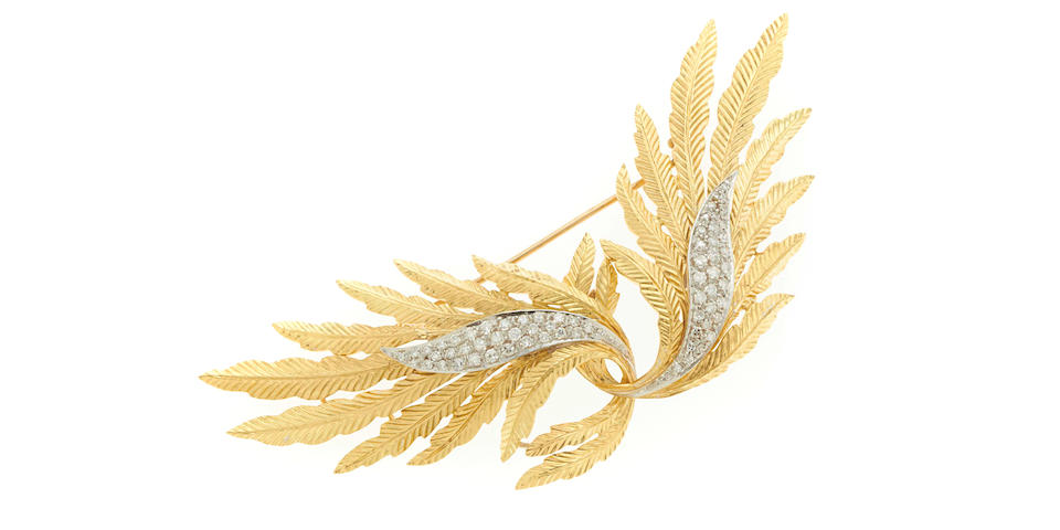 A diamond and 18k bicolor gold leaf brooch