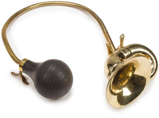 Property from the Collection of Joel Finn A brass double twist horn with bulb and bracket