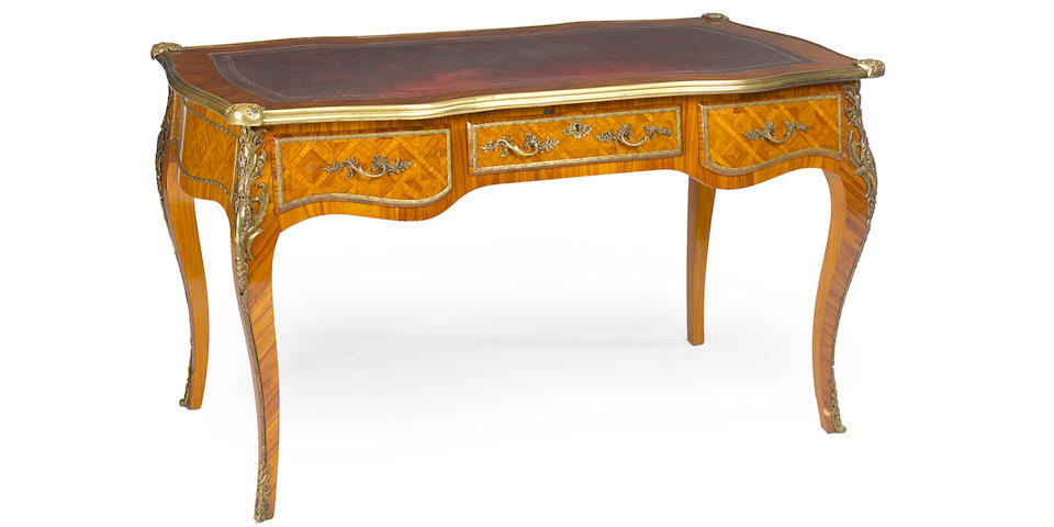 A Louis XV style gilt bronze mounted walnut writing table 20th century