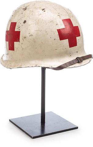 D-DAY: US ARMY RANGERS MEDIC HELMET, IN ACTION 6 JUNE 1944 11 x 9 x 7in (28 x 23 x 18cm)