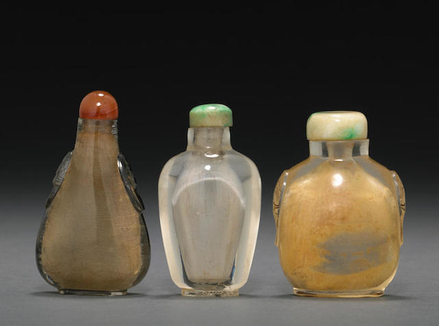 A group of three rock crystal snuff bottles