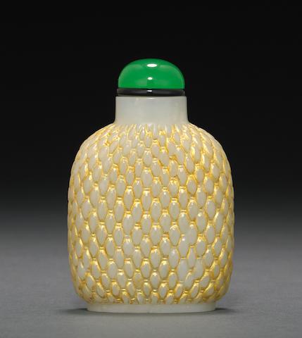 A carved jade basket weave gilt embellished snuff bottle