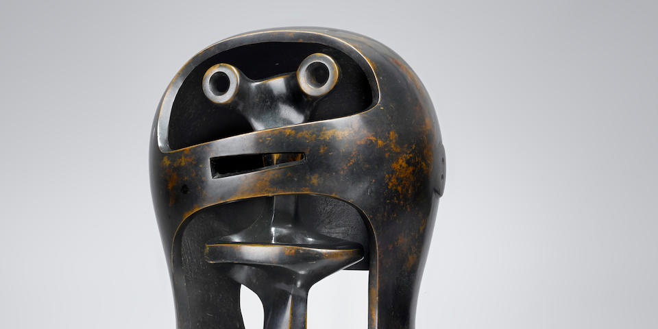 HENRY MOORE O.M., C.H. (1898-1986) Helmet Head no. 2 13 1/4 in (33.5 cm) (height); the interior element: 12 1/8 in (30.9 cm) (height) (Conceived in 1950 and cast in 1955 in an edition of nine)