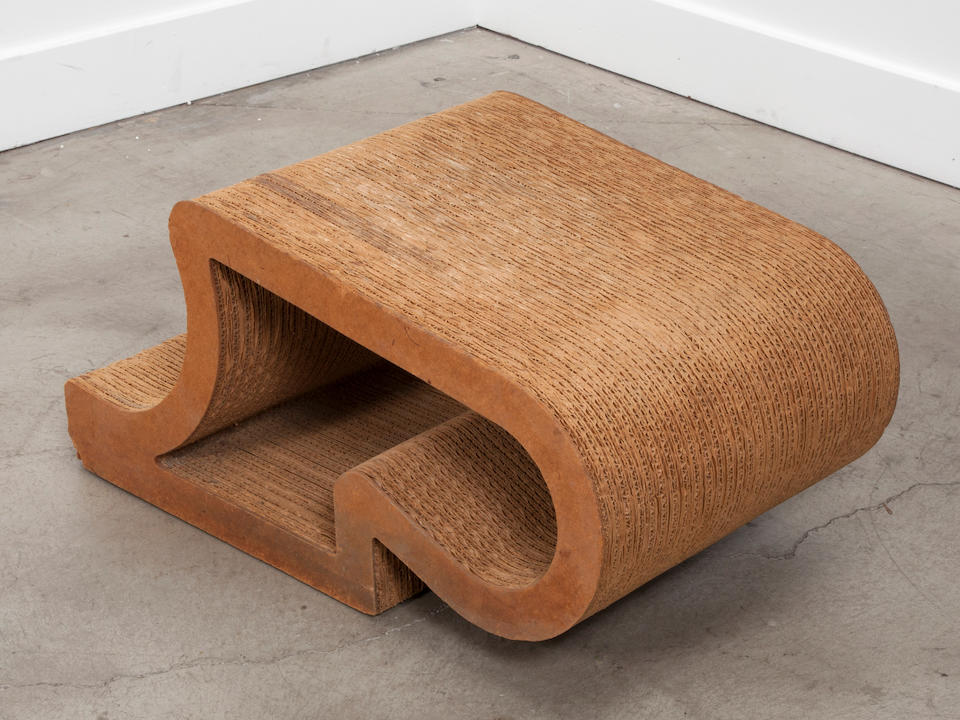 Frank Gehry (born 1929) Easy Edges ottoman designed 1972, this example manufactured by Easy Edges, Inc. corrugated cardboard, Masonite height 14 1/2in (37cm); width 30 1/4in (76.5cm); depth 18 1/4in (46.5cm)