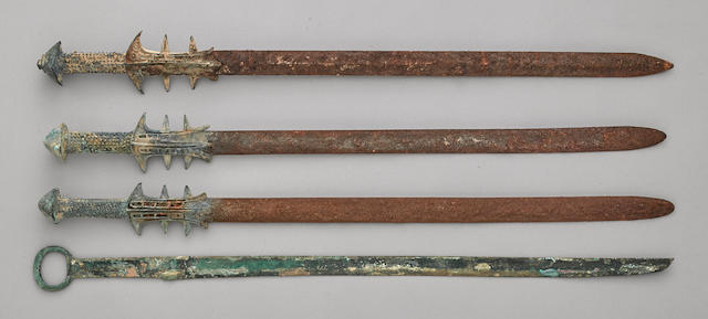 A group of four archaic bronze swords Warring States to Han dynasty