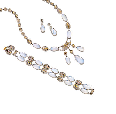 A set of moonstone, platinum and gold jewlery, attributed to Louis Comfort Tiffany, Tiffany & Co., circa 1915, and a pair of white gold and moonstone earrings