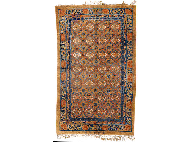A silk and metal Chinese rug China size approximately 5ft. 1in. x 8ft. 4in.