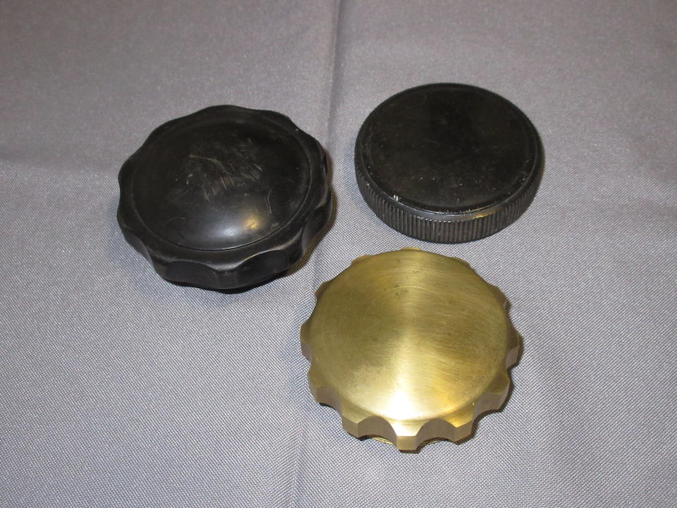 Property from the Collection of Joel Finn Four radiator caps, two new, two old