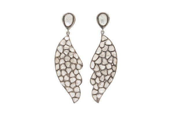 A pair of diamond wing motif earrings