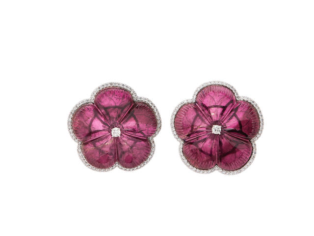 A pair of carved tourmaline and diamond flower earrings
