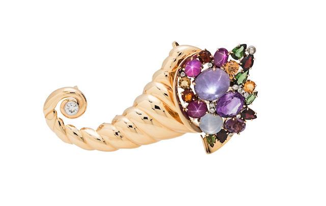 A gem-set, diamond cornucopia clip-brooch