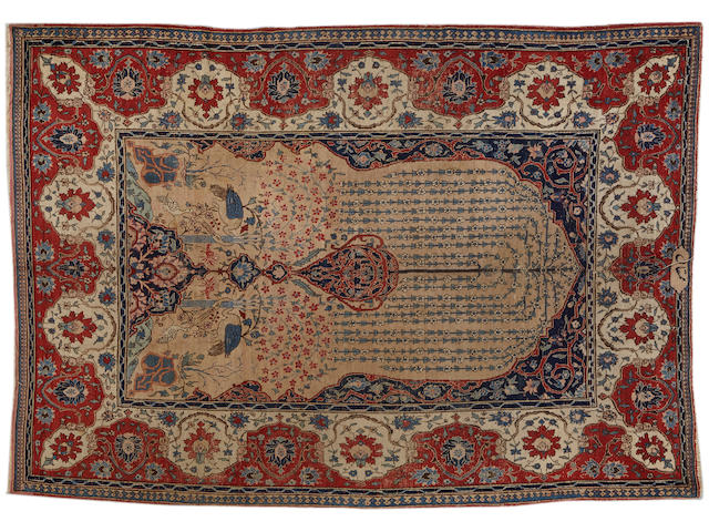 A Tabriz carpet  size approximately 8ft. 1in. x 11ft.