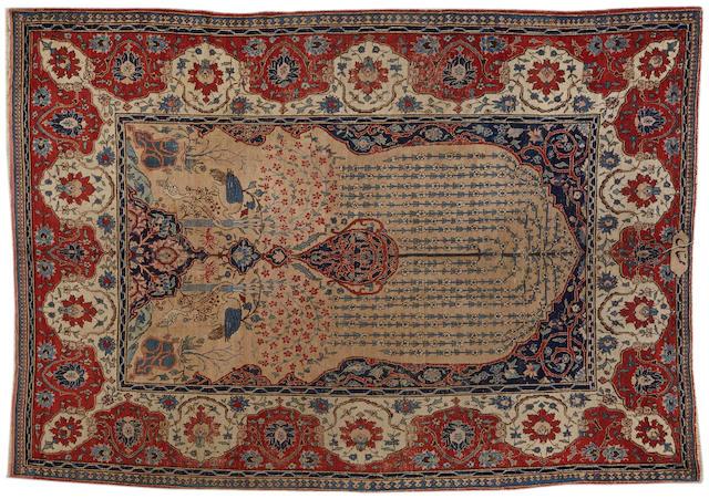 A Tabriz carpet  size approximately 8ft. 1in. x 11ft.